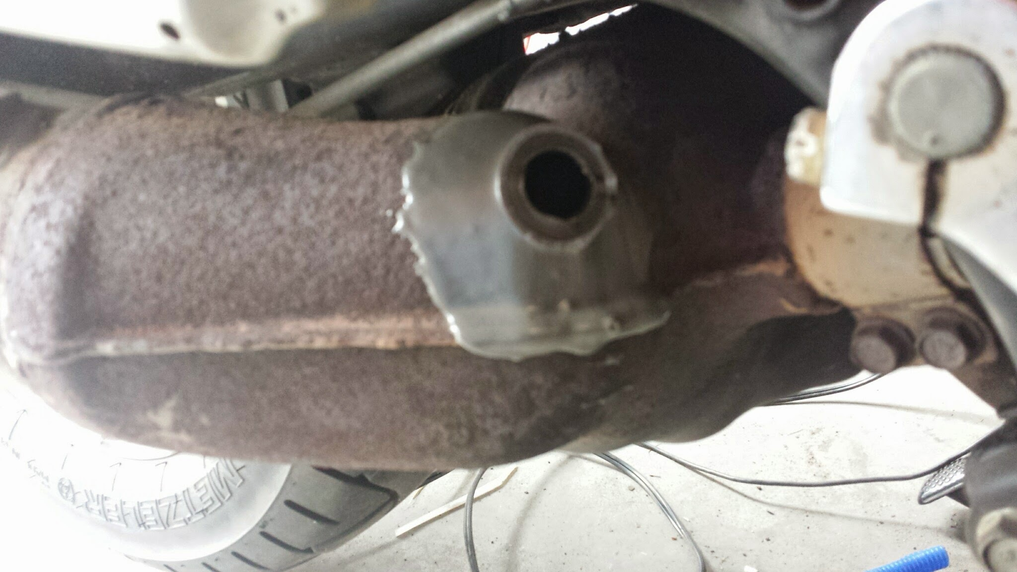 Welding up the O2 exhaust sensor bung on the PC800 – Not ...